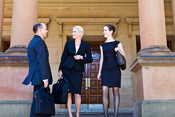 Business people on steps