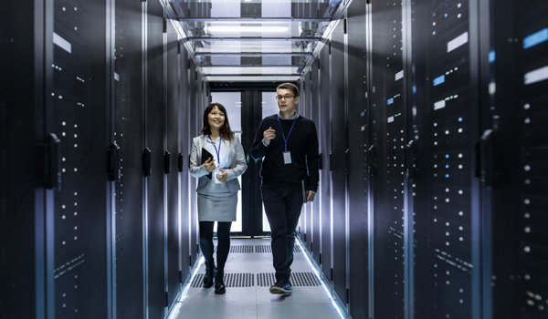 Two people walking in data room