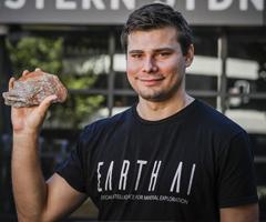 Roman Teslyuk holding a mineral rock