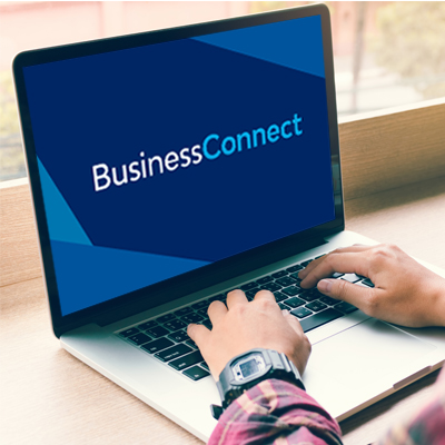 Person using laptop with Business Connect on screen